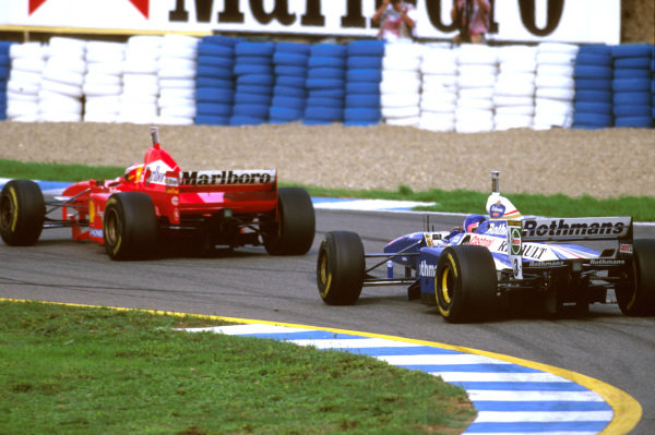 Jerez, Spain.24-26 October 1997.Jacques Villeneuve (Williams FW19 Renault) following Michael Schumacher (Ferrari F310B) before their coming together on lap 47.Ref-97 EUR 32.World Copyright - LAT Photographic