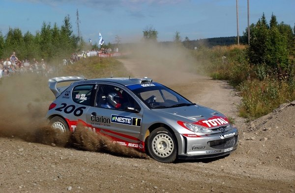 Richard Burns (GBR) was attempting to become the first Briton to win the Rally Finland in his Peugeot 206 WRC.FIA World Rally Championship, Neste Rally Finland, Rd9, Finland. Day One. 9 August 2002.DIGITAL IMAGE