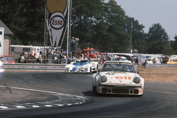 "Le Mans, France. 12th - 13th June 1976.""Marie-Claude Beaumont""/Didier Pironi/Bob Wollek (Porsche 934), 19th position, leads Jean-Marie Lemerle/Alain Levie/Patrick Daire (Lola T294 ROC), Not classified, action. World Copyright: LAT Photographic.Ref: 76LM18."