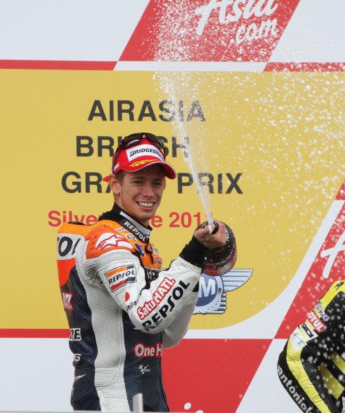 British Grand Prix. Silverstone, England. 10th-12th June 2011. Casey Stoner, Honda, celebrates on the podium. World Copyright: Kevin Wood/LAT Photographic. ref: Digital Image