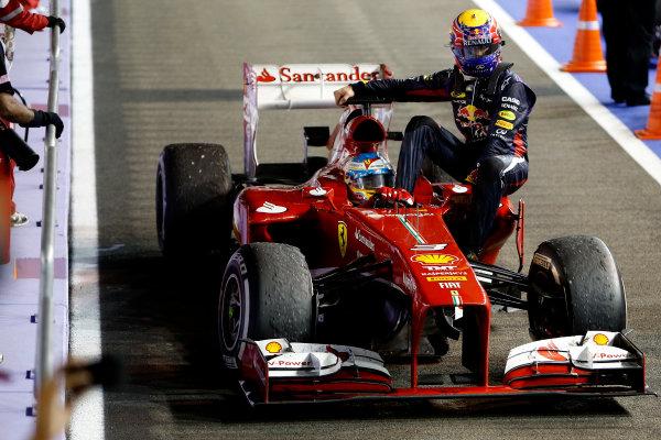 Marina Bay Circuit, Singapore. Sunday 22nd September 2013.  Mark Webber, Red Bull Racing, gets a lift back with Fernando Alonso, Ferrari F138.  World Copyright: Glenn Dunbar/LAT Photographic. ref: Digital Image _89P1189