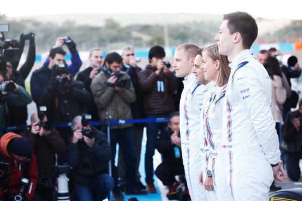 2015 F1 Pre Season Test 1 - Day 1 Circuito de Jerez, Jerez, Spain. Sunday 1 February 2015. Valtteri Bottas, Williams F1, Felipe Massa, Williams F1, Susie Wolff, Development Driver, Williams F1, and Alex Lynn, Williams F1, launch the William FW37 in front of the media. World Copyright: Alastair Staley/LAT Photographic. ref: Digital Image _R6T3109