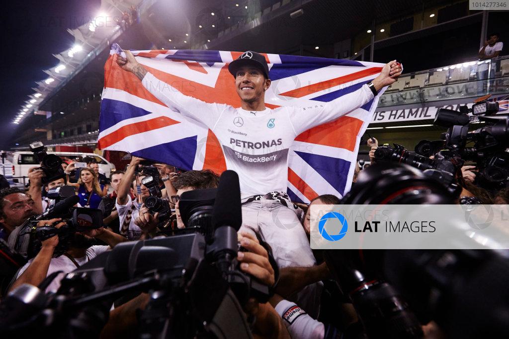 Yas Marina Circuit, Abu Dhabi, United Arab Emirates. Sunday 23 November 2014.  Lewis Hamilton, Mercedes AMG, celebrates championship victory.  World Copyright: Steve Etherington/LAT Photographic. ref: Digital Image SNE13431