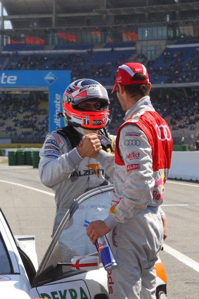 Congratulations from Martin Tomczyk (GER), Audi Sport Team Abt Sportsline, for Gary Paffett (GBR), Salzgitter AMG Mercedes, who took pole position.DTM, Rd1, Hockenheim, Germany, 23-25 April 2010 World Copyright: LAT Photographicref: Digital Image dne1024ap34