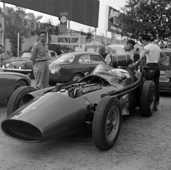 The Maserati 250F, driven by Horace Gould, in the paddock would not start the race due to a fuel system problem.