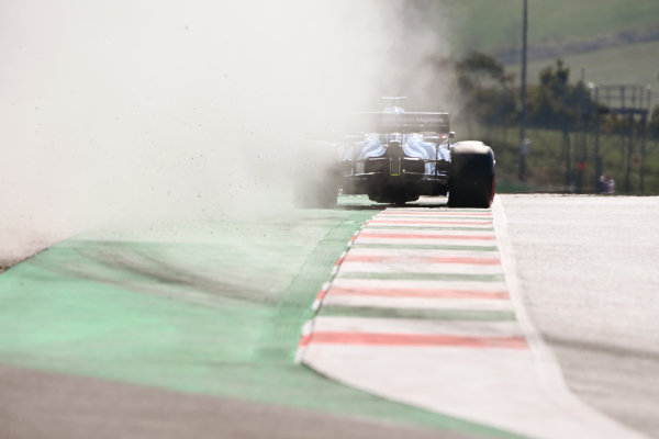 Daniil Kvyat, AlphaTauri AT01, leaves a trail of dust in his wake after running wide