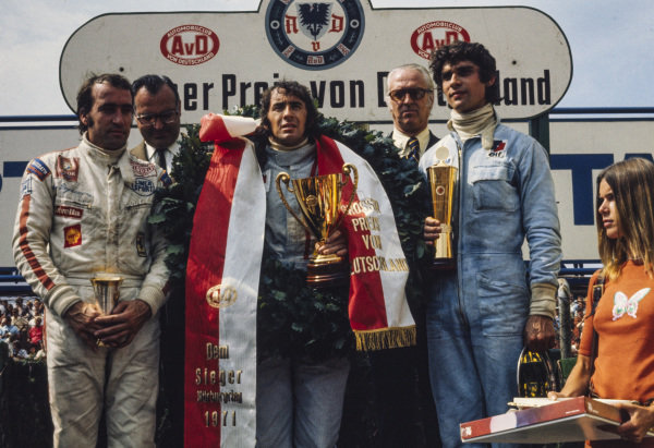 Jackie Stewart celebrates victory on the podium with team mate and François Cevert, 2nd position, wife Helen (far R) and Clay Regazzoni, 3rd position.
