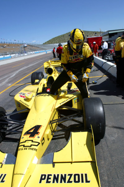 2003 Phoenix IRL IndyCar, 21-23 March 2003; Phoenix International Raceway; Phoenix, Arizona USASam Hornish climbs from his car after practice-2003 Lesley Ann Miller, USALAT Photographic