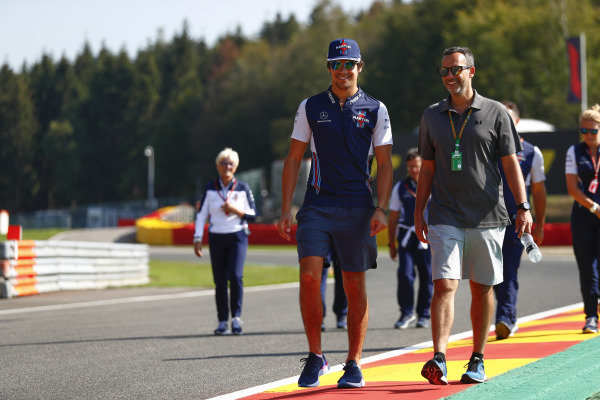 Lance Stroll, Williams Racing, walks the circuit with colleagues.