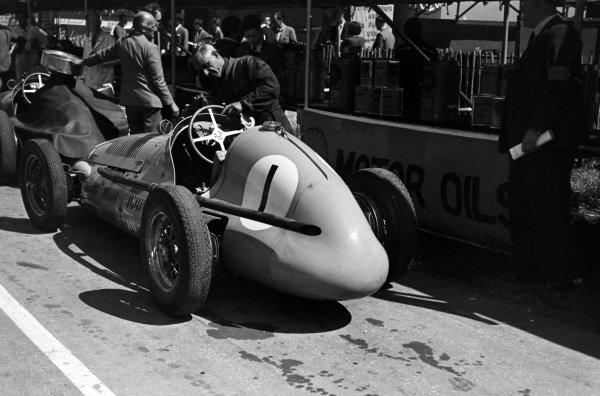 "A mechanic checks the steering wheel on the Maserati 4CLT of ""B.Bira""."