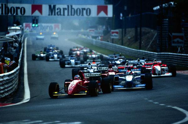 1995 Belgian Grand Prix.Spa-Francorchamps, Belgium.25-27 August 1995.Jean Alesi (Ferrari 412T2) leads at the start.World Copyright - LAT Photographic