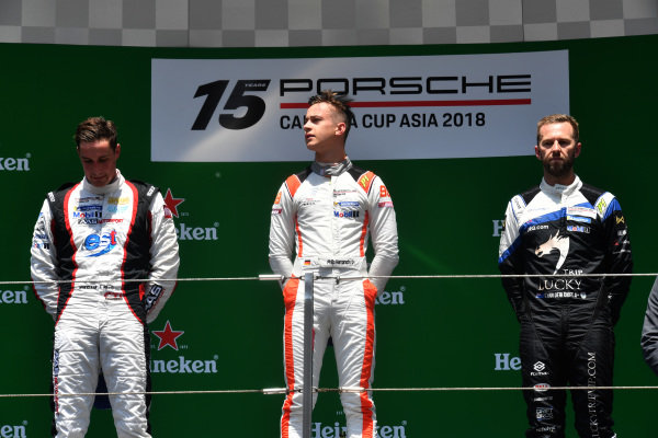 (L to R): Second placed Maxime Jousse (THA) AAS Motorsport by Absolute Racing, race winner Philip Hamprecht (GER) Team StarChase and third placed Chris Van Der Drift (NZL) Team Formax on the podium at Porsche Carrera Cup Asia, Shanghai, China, 13-15 April 2018.