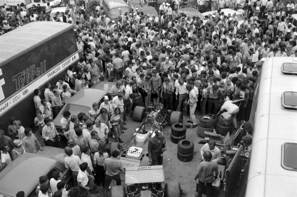 Fans swarm the paddock.