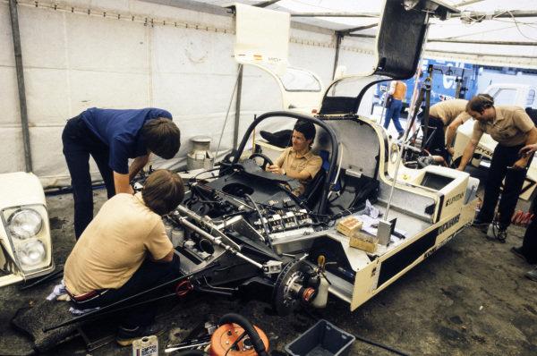 Emilio de Villota / Alain De Cadenet / Desire Wilson, G.R.I.D. Racing, Grid S1, in the paddock being worked on by the mechanics.