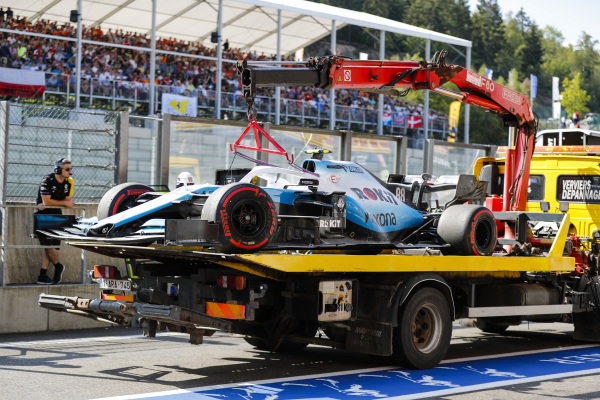 The Robert Kubica Williams FW42 is returned to the pit lane on a truck