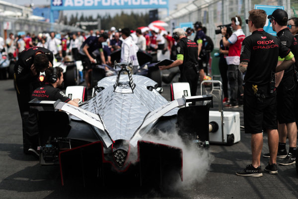 Jose Maria Lopez (ARG)'s GEOX Dragon Racing Penske EV-3 on the grid surrounded by engineers