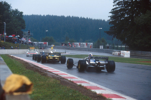 Spa-Francorchamps, Belgium.25-27 August 1995.The safety car leads Michael Schumacher (Benetton B195 Renault), Roberto Moreno (Forti FG01-95) and Damon Hill (Williams FW17 Renault) through the Bus Stop Chicane.Ref-95 BEL 18.World Copyright - LAT Photographic