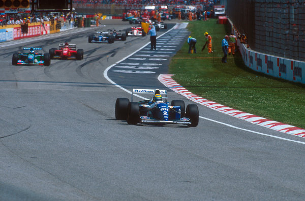 Imola, Italy.29/4-1/5 1994.Ayrton Senna (Williams FW16 Renault) leads the rest of the field behind the safety car which was brought out after the Lehto/Lamy startline shunt. Marshalls clear the track behind.Ref-94 SM 23.World Copyright - LAT Photographic