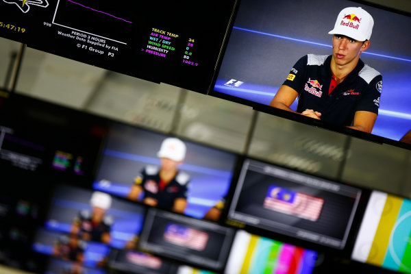 Sepang International Circuit, Sepang, Malaysia. Thursday 28 September 2017. Pierre Gasly, Toro Rosso, is pictured on monitors in the media centre. World Copyright: Andy Hone/LAT Images  ref: Digital Image _ONZ8600