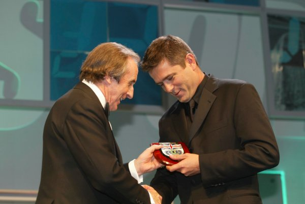 2003 AUTOSPORT AWARDS, The Grosvenor, London. 7th December 2003.Gil De Ferran receives a BRDC award and honorary membership from Sir Jackie Stewart.Photo: Peter Spinney/LAT PhotographicRef: Digital Image only