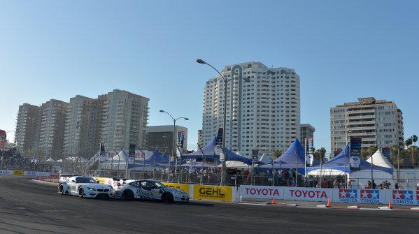 19-20 April, 2013, Long Beach, California.#56 BMW Team RLL BMW Z4 GTE bumping #27 Porsche Cup GT3 ©2013 Dan R. Boyd LAT Photo USA