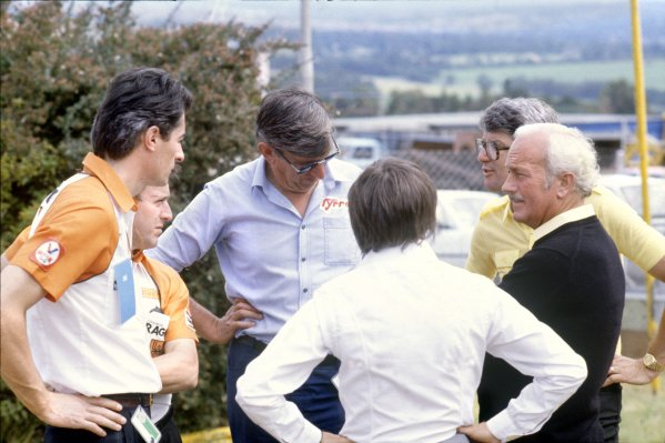 1982 South African Grand Prix.Kyalami, South Africa. 23 January 1982.Team owners and sponsors discuss the proposed drivers strike - left to right: Daniele Audetto, Alan Rees, Ken Tyrrell, Bernie Ecclestone, Peter Warr and Colin Chapman.World Copyright: LAT PhotographicRef: 35mm transparency 82SA42