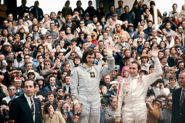 Jarama, Madrid, Spain.29/4-1/5 1972.Emerson Fittipaldi (Lotus 72D-Ford), 1st position and Clay Regazzoni (Ferrari 312B2), 3rd position on the podium, portrait. World Copyright: LAT Photographic.Ref:  72ESP45.