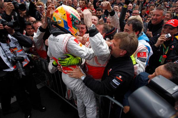 Nurburgring, Germany.24th July 2011.Lewis Hamilton, McLaren MP4-26 Mercedes, 1st position, celebrates with his team in Parc Ferme. Portrait. Helmets. Finish. World Copyright: Steven Tee/LAT Photographicref: Digital Image _I4V2256