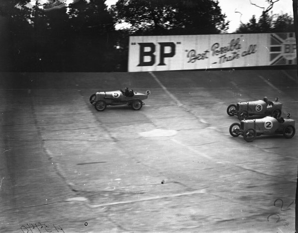 1924 JCC 200 Mile Race. Brooklands, Great Britain. September 1924. Eddie Hall (#5) leads Major Frank Halford (#3) and Cyril Maurice Harvey (#2), Aston Martin, Alvis, action.  World Copyright: LAT Photographic.  Ref:  Autocar Glass Plate A3990.