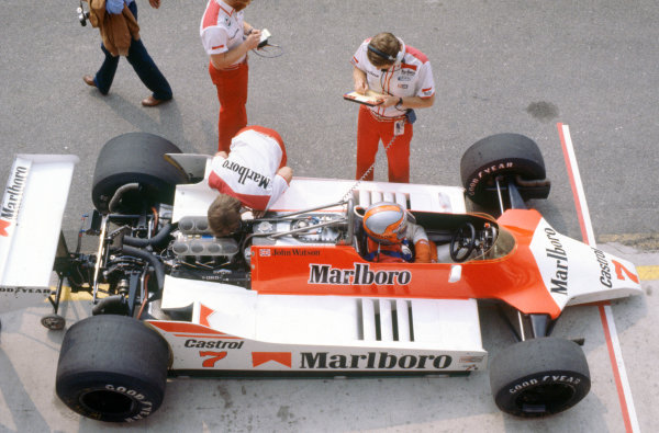 Imola, Italy. 12-14 September 1980. John Watson (McLaren M29C-Ford Cosworth) in the pits. Tyler Alexander stands by the car.World Copyright: LAT PhotographicRef: 35mm transparency 80ITA14