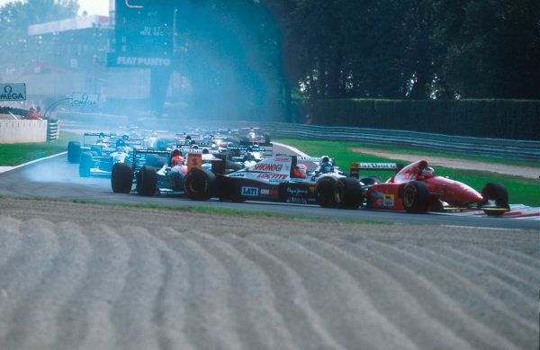 1994 Italian Grand Prix.Monza, Italy.9-11 September 1994.Johnny Herbert (Lotus 109 Mugen-Honda) is spun round at the Rettifilo Chicane at the start by Eddie Irvine (Jordan 194 Hart) because he could not brake as quickly as him so ended up hitting him from behind. Everybody else takes avoiding action in the melee.Ref-94 ITA 05.World Copyright - LAT Photographic