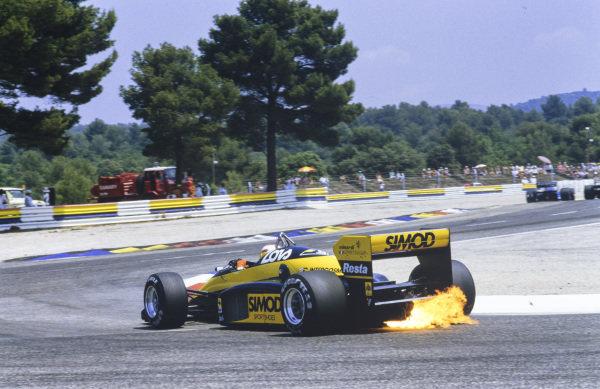 Adrián Campos, Minardi M187 Motori Moderni, with flames at the rear.