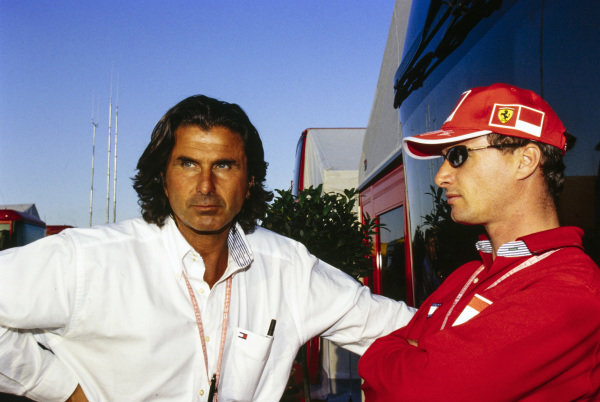 Eddie Irvine with his manager Enrico Zanarini.