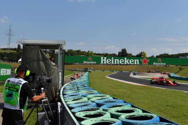 Sebastian Vettel (GER) Ferrari SF-71H and cameraman