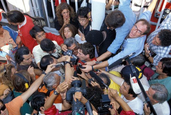Ayrton Senna talks to the media.
