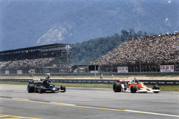 James Hunt, McLaren M26 Ford, leads Ronnie Peterson, Lotus 78 Ford.