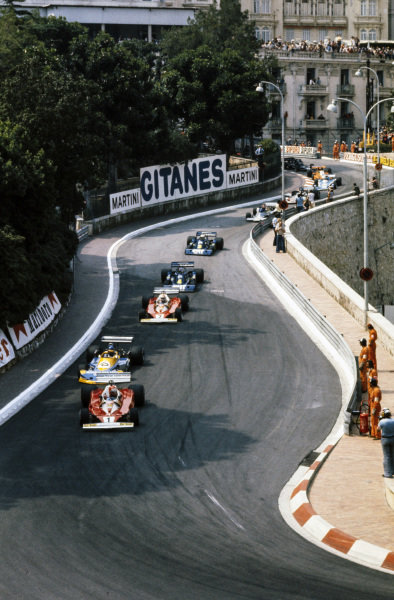 Niki Lauda, Ferrari 312T2 leads Ronnie Peterson, March 761 Ford, Clay Regazzoni, Ferrari 312T2 and Patrick Depailler, Tyrrell P34 Ford.