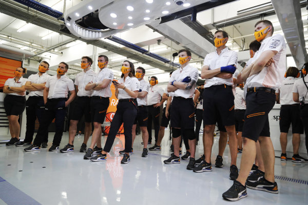 The McLaren team follow the action on the monitors during qualifying