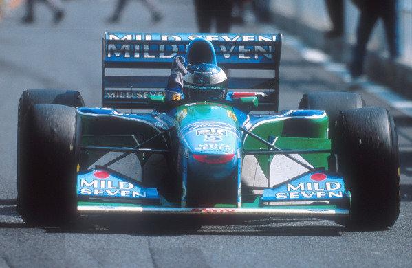 1994 Pacific Grand Prix. Tanaka International, Aida, Japan. 15-17 April 1994. Michael Schumacher (Benetton B195 Ford) celebrates 1st position. Ref-94 PAC 09. World Copyright - LAT Photographic