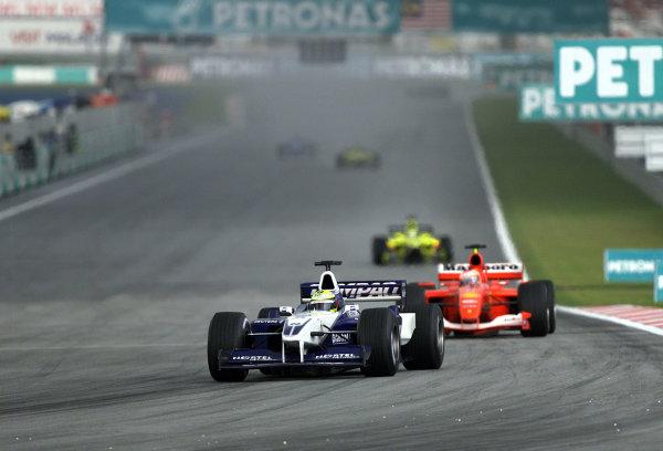 2001 Malaysian Grand Prix.Sepang, Kuala Lumpur, Malaysia. 16-18 March 2001.Ralf Schumacher (Williams FW23 BMW) followed by Rubens Barrichello (Ferrari F2001).World Copyright - Steve Etherington/LAT Photographic.ref: 18mb Digital Image