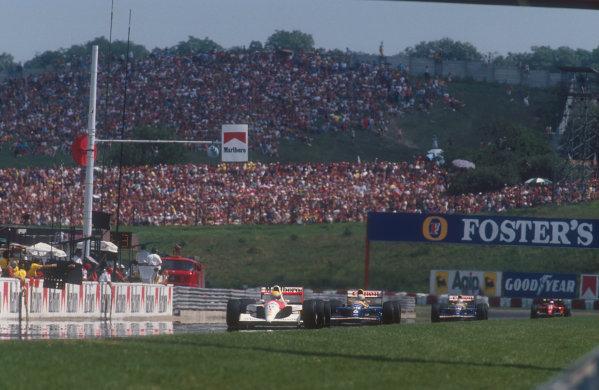 1991 Hungarian Grand Prix. Hungaroring, Budapest, Hungary 9-11 August 1991 Ayrton Senna (McLaren MP4/6 Honda) leads Riccardo Patrese and Nigel Mansell, (both Williams FW14 Renault's) ahead of Alain Prost (Ferrari 643). Ref-91 HUN 02 World Copyright - LAT Photographic