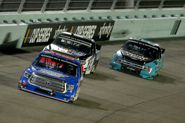 Stewart Friesen, Halmar Friesen Racing Toyota Halmar Racing to Beat Hunger, leads a pack of cars, Copyright: Michael Reaves/Getty Images.