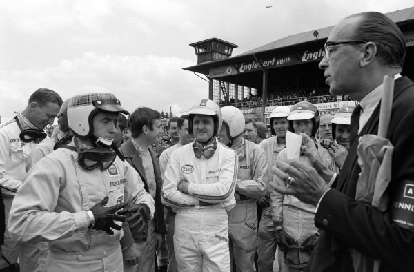 Dan Gurney, Jackie Stewart, Chris Amon, Denny Hulme, Richard Attwood and Jochen Rindt are among the drivers at the briefing.