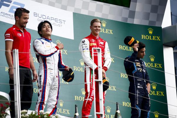 HUNGARORING, HUNGARY - AUGUST 04: Nobuharu Matsushita (JPN, CARLIN), Race winner Mick Schumacher (DEU, PREMA RACING) and Sergio Sette Camara (BRA, DAMS) on the podium during the Hungaroring at Hungaroring on August 04, 2019 in Hungaroring, Hungary. (Photo by Andy Hone / LAT Images / FIA F2 Championship)