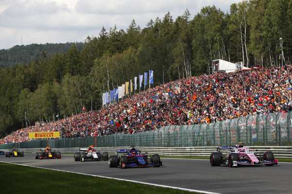 Lance Stroll, Racing Point RP19, leads Daniil Kvyat, Toro Rosso STR14 and Antonio Giovinazzi, Alfa Romeo Racing C38