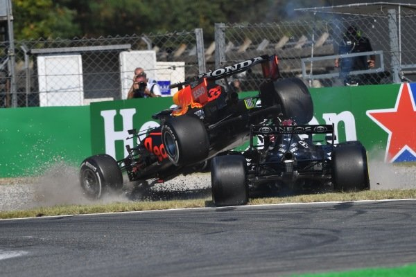 Max Verstappen, Red Bull Racing RB16B, and Sir Lewis Hamilton, Mercedes W12, collide