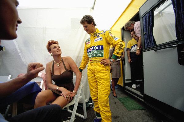 Michael Schumacher chats to actress Brigitte Nielsen.