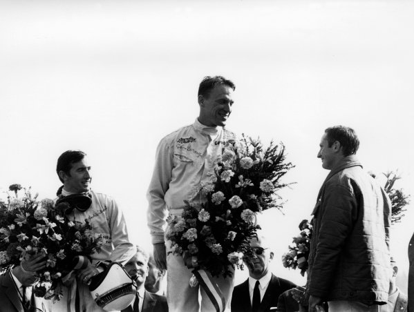 Spa-Francorchamps, Belgium. 18th June 1967. Dan Gurney, Eagle AAR104-Weslake, 1st position with Jackie Stewart, BRM P83, 2nd position and Chris Amon, Ferrari 312, 3rd position, on the podium, portrait.  World Copyright: LAT Photographic Ref: B/W Print.