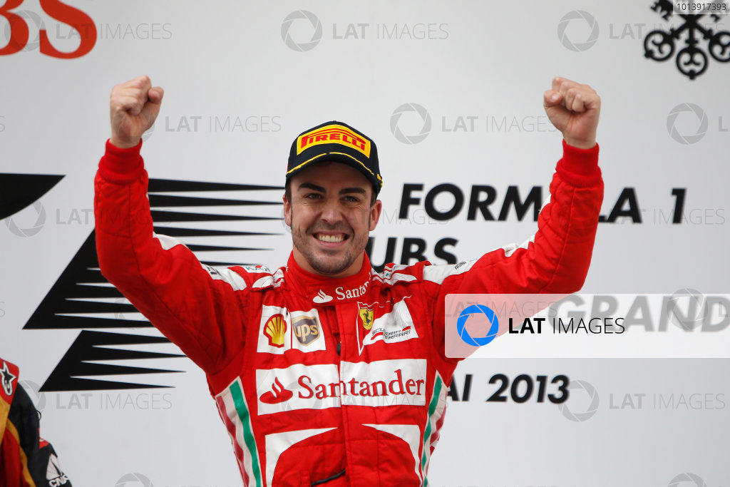 Shanghai International Circuit, Shanghai, China Sunday 14th April 2013 Fernando Alonso, Ferrari, 1st position, celebrates on the podium. World Copyright: Glenn Dunbar/LAT Photographic ref: Digital Image _89P8918