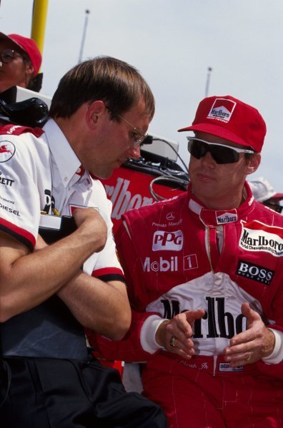 Al Unser Jr (USA) Penske Racing talks with his engineer.PPG IndyCar World Series, Indianapolis 500, Indianapolis, USA, 9-13 May 1994.
